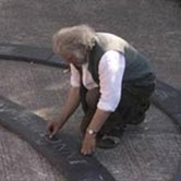 Ieuan mapping out slates for an inlaid design for the DVLA.