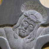 Detail of bass relief carving, depicting Jesus.