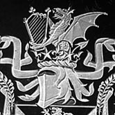 Coat of Arms with dragons and feathers surrounding a shield.