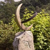 Hand carved sundial with with celtic boar detail.