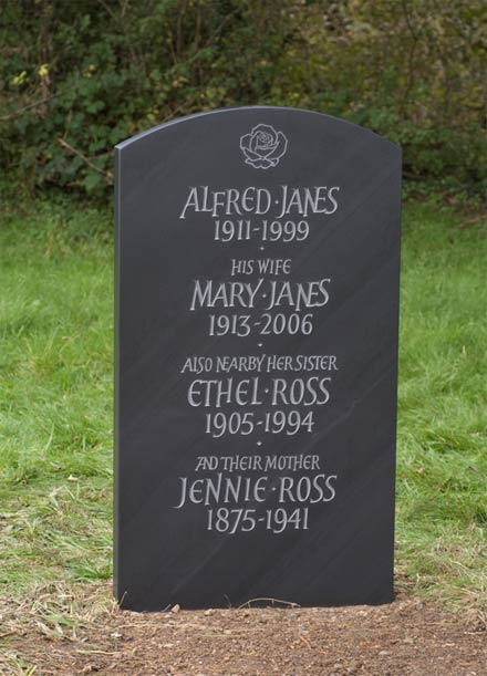 Hand Carved Headstone example, showing use of Free Roman Type Styling with Rose detail.