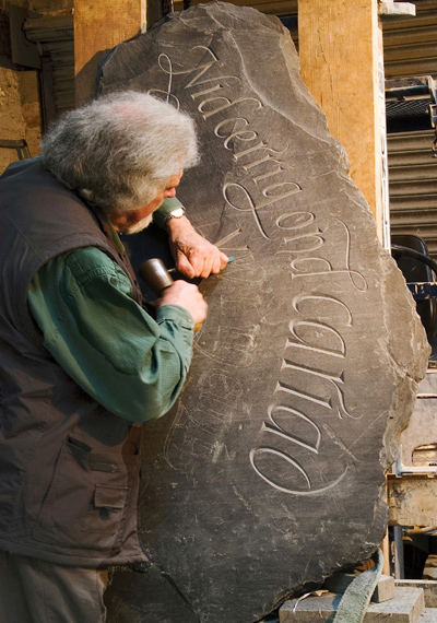 Ieuan Carving a Commemorative / Memorial Boulder.
